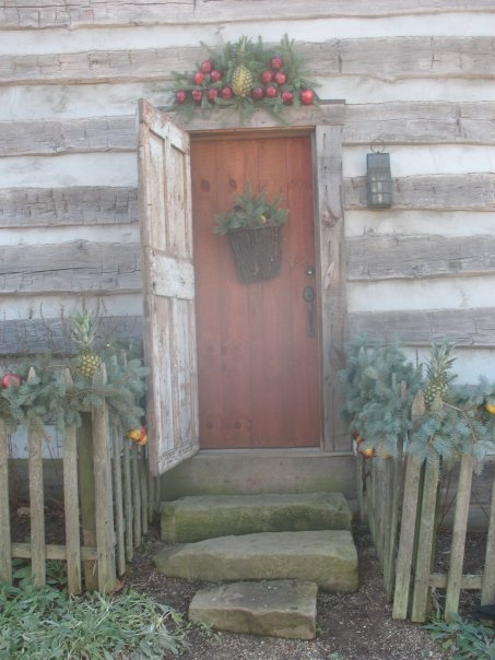 Williamsburg Log Cabin Front Door With Stone Steps & Picket Fence