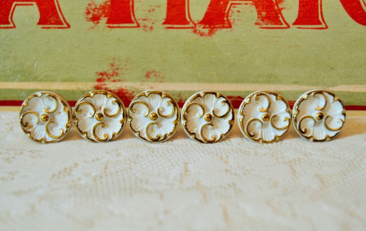 Set of 6 Vintage White Floral Drawer Pulls, Knobs, Cabinetry Hardware; Brass by Trashtiques on Etsy https://www.etsy.com/ca/listing/480493268/set-of-6-vintage-white-floral-drawer