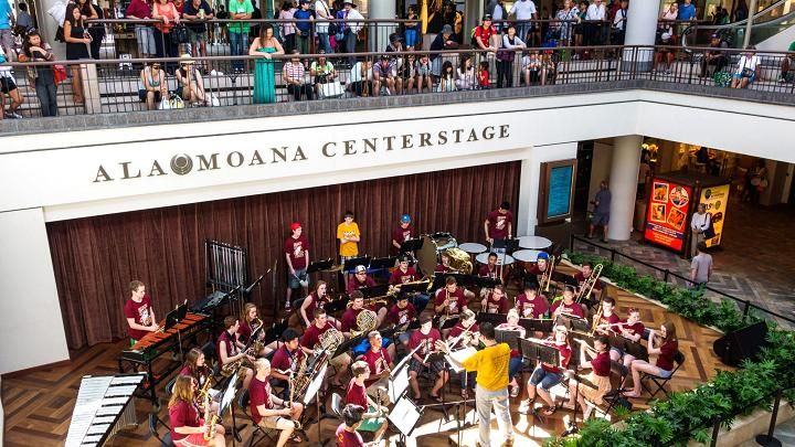 A high school band performing on stage at the Ala Moana Center in Honolulu, Hawaii.