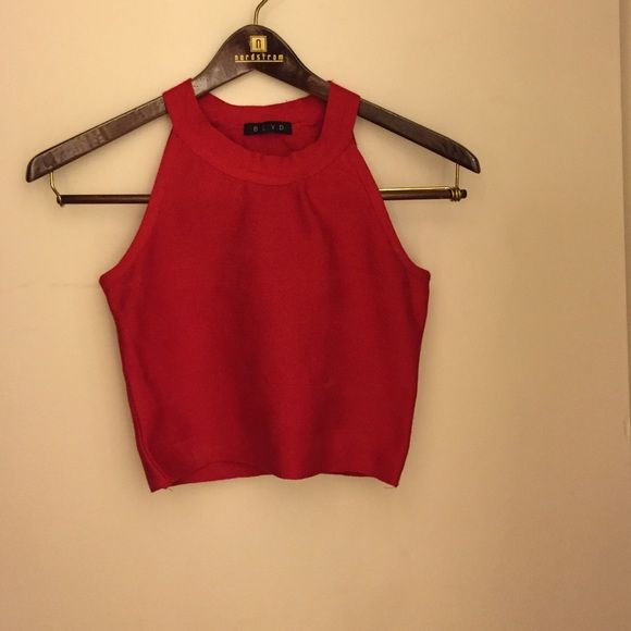 Red Crop Top Add a little red to your wardrobe with this cotton/spandex blend crop top. Tops Crop Tops