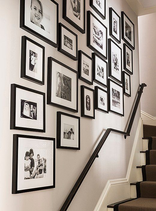 Elegant A Gallery Wall Of Framed Family Photos Up The Entryway Staircase Looks  Extra Chic In