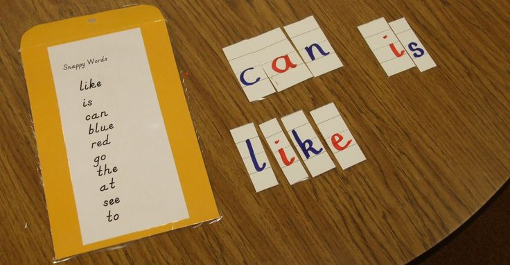Children put sight words that have been written on sentence strips back together in this center from Theresa Miller's class.