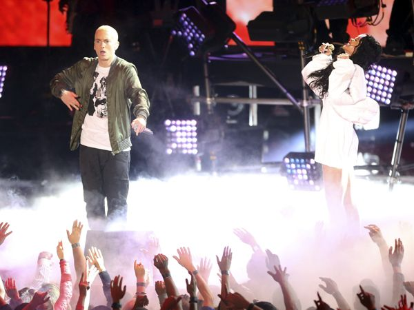 Eminem Rihanna MTV Movie Awards http://www.rollingstone.com/music/news/eminem-and-rihanna-debut-the-monster-at-mtv-movie-awards-20140413 http://www.mtv.com/videos/misc/1029861/the-monster-feat-rihanna-live.jhtml