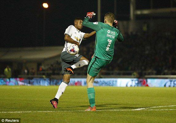 Marcus Rashford takes advantage of Adam Smith mistake before scoring United's third