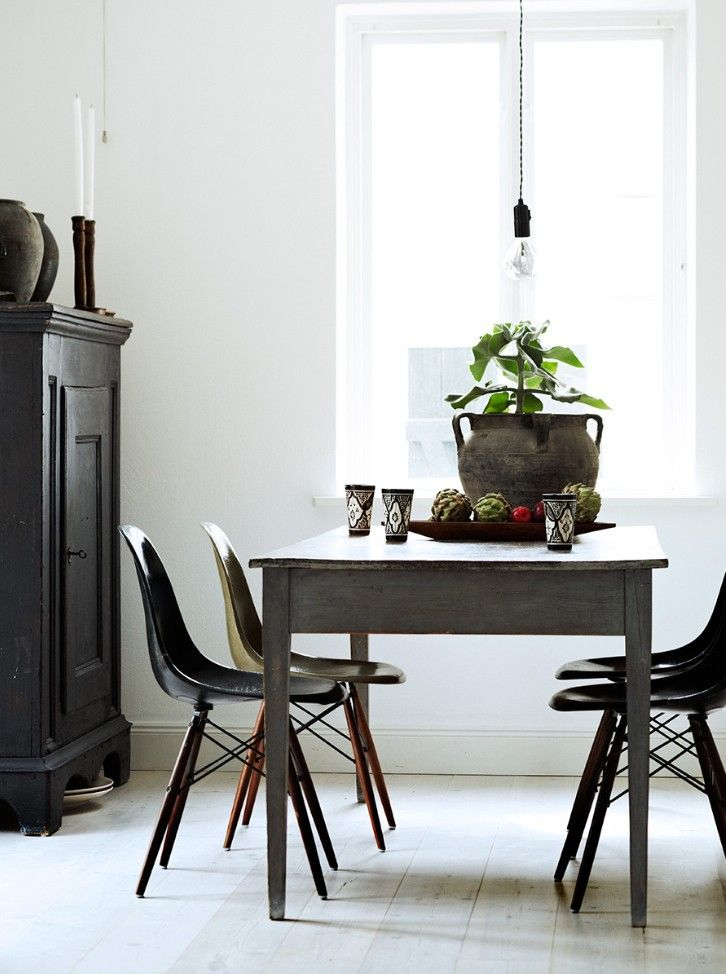 Modern (Eames chairs in earth tones) paired with farmhouse table ... for my kitchen.  from The Stuff of LIfe by Hilary Robertson, Photography by Anna Williams | Remodelista