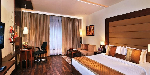 A luxurious bed, plush furnishing and elegant decor in our suite at Country Inn & Suites By Carlson, Sector-12, Gurgaon make your stay a little extra special!