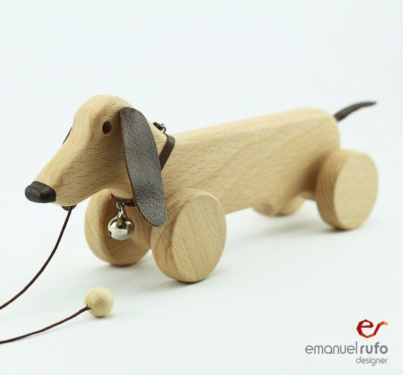 Personalized Wooden Toy, wooden Dog, eco-friendly pull toy This pull along Dog, stands out from the traditional pull along toys due to its unique and original design. Its the perfect gift for your child. This is a completely safe toy, entirely handmade in natural hard maple wood with applications in natural leather, and finished by hand with non-toxic acrylic varnish especially suitable for children.  Personalization: we can personalize your wooden Dog with the name that you want (up to 12…