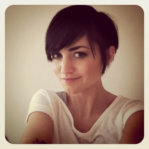 Pixie Cut with long bangs.