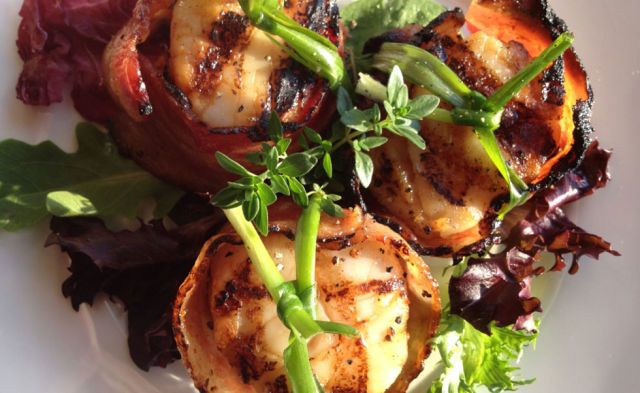 This sophisticated take on bacon involves sprinkling scallops with cayenne pepper and brown sugar, then fastening bacon around each scallop with a metal skewer and popping them in the oven.  Get the recipe at Lemony Thyme.   - CountryLiving.com