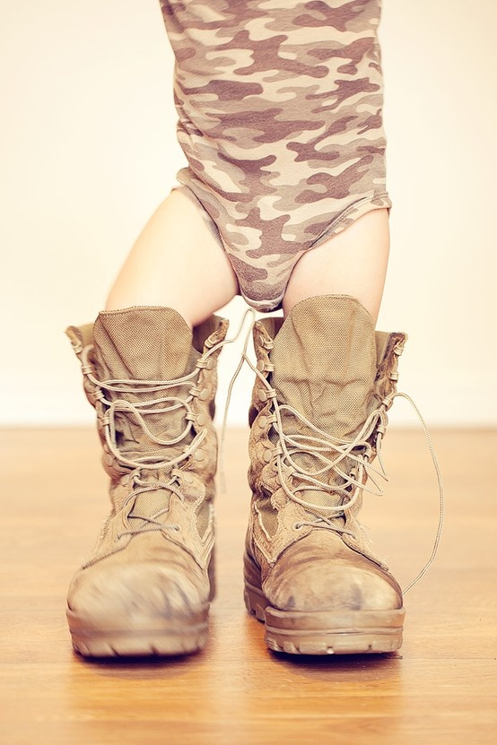 Reminds me of my babies always trying to wear daddy's boots.