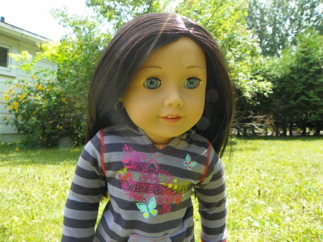 """Light skin, black-brown hair, blue eyes Your girl can create a unique personality for her My American Girl® doll! This doll is 18"""" tall, with blue eyes that open and close. She has light skin and"""