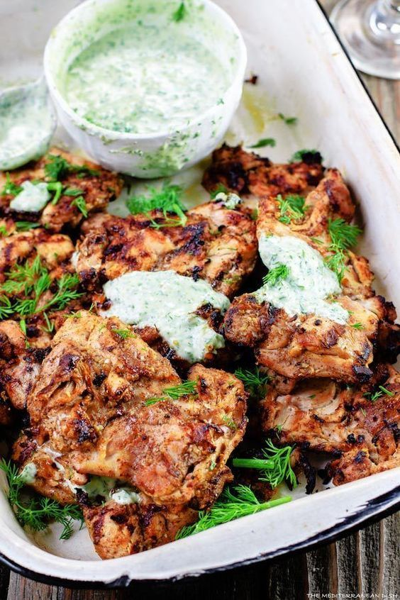 Mediterranean Grilled Chicken + Dill Greek Yogurt Sauce. Top grill recipe! Marinate boneless chicken thighs in Mediterranean spices, olive oil and lemon juice. Grill for less than 15 minutes, and serve with this flavor-packed dill yogurt sauce!