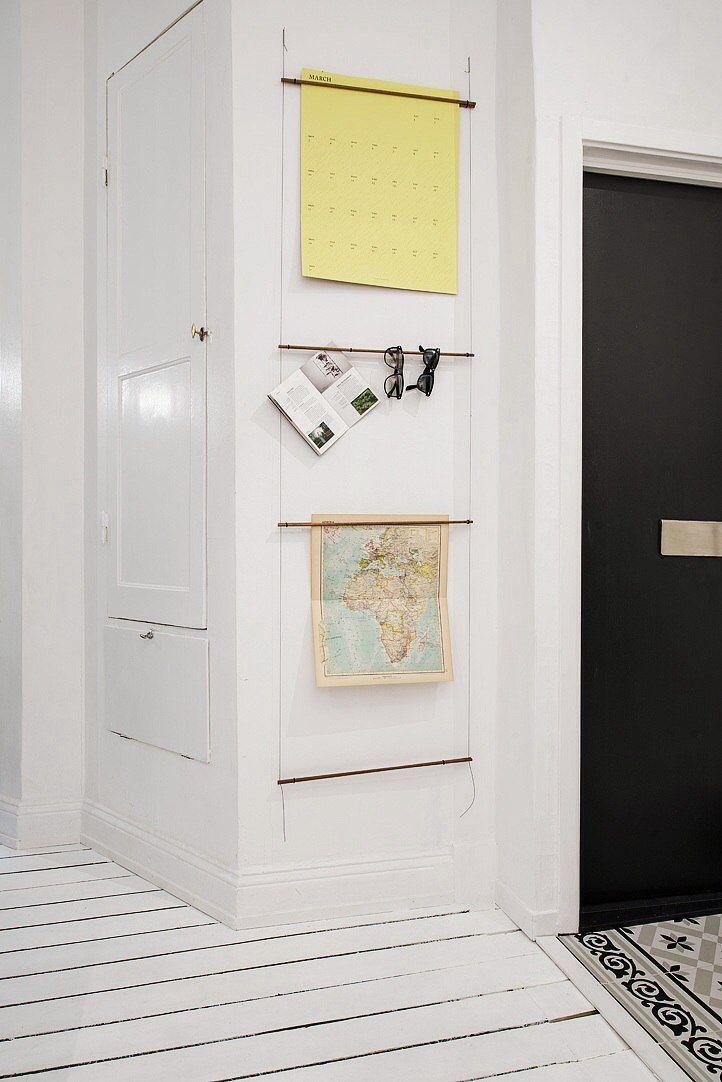 прихожая. Очень нравится плитка на полу выложенная в виде коврика. И также понравилась идея с палками и веревкой для хранения ...как она может называться ? :)