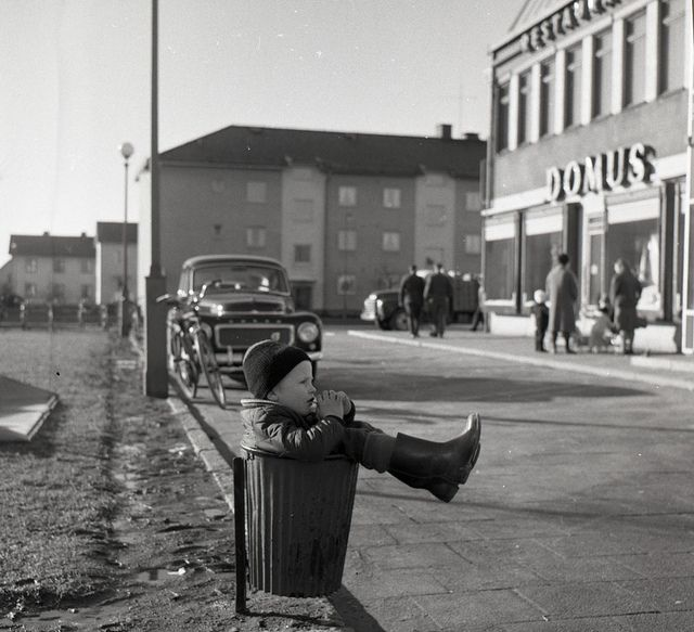 Someone threw out a perfectly good boy!      Boy Resting in Trash can, Gothenburg, 1961    From Stockholm Transport Museum