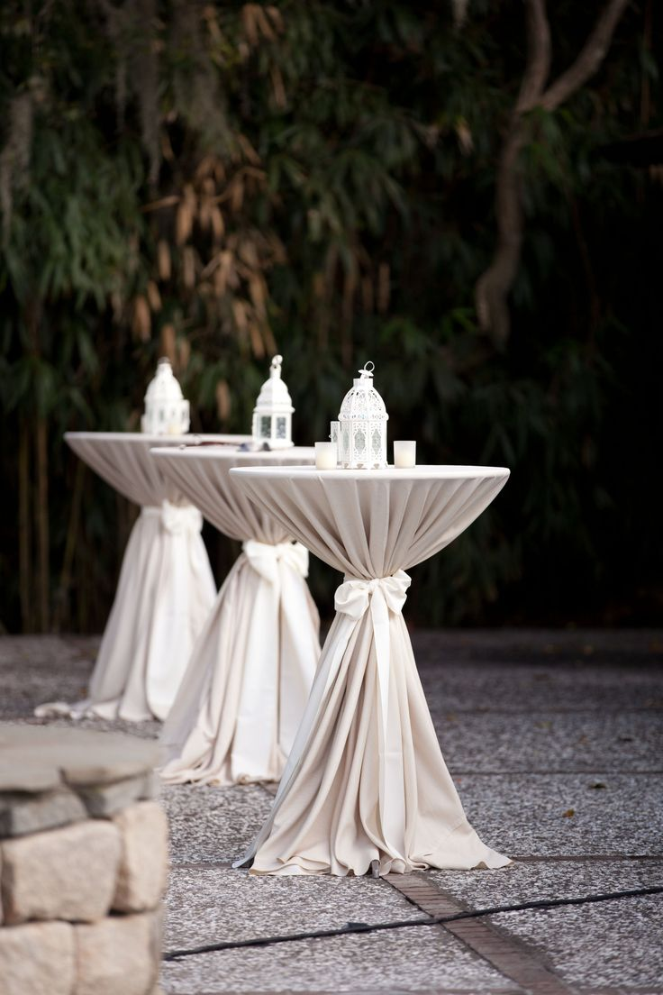 Cocktail tables. Tan linens with ivory bow (by Yoj Events ...