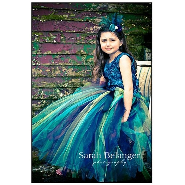 Alyssa, this looks like something you'd have. :) Peacock flower girl dress.
