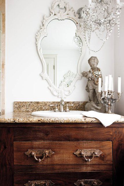 White vintage mirror against a white wall, natural colors in granite top, pure creativity in Kansas City Spaces