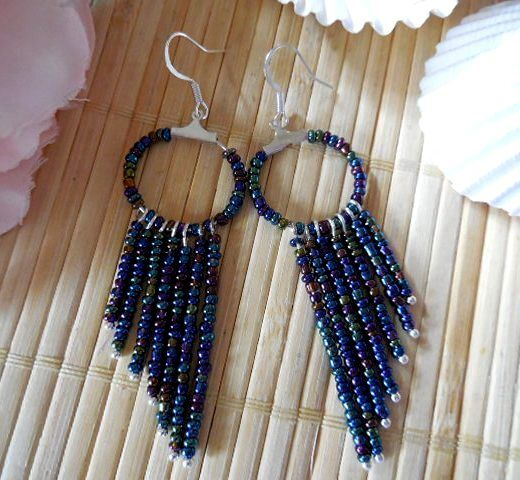 Beaded hoop earrings using tiny seed beads in blues, greens & bronzes, silver plated ball head pins & silver plated ear wires.