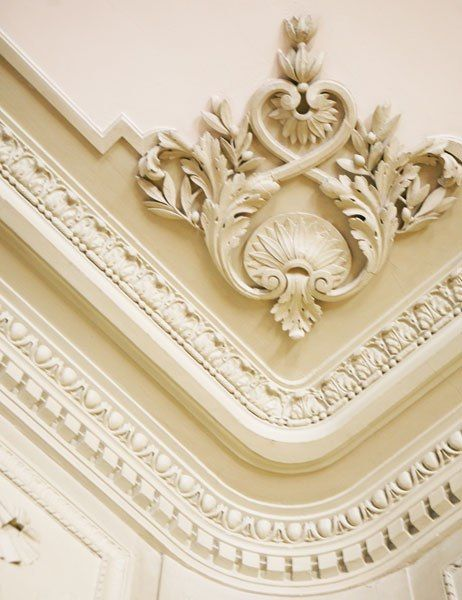 a detail of the salons plaster crown moldings at the muse nissim de camondo in paris