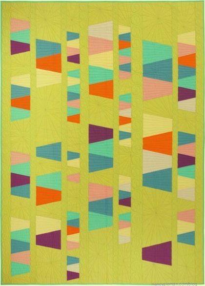 This quilt features four sizes of the traditional tumbler blocks turned the side—sewn in columns not rows. Notice the use of negative space. Learn more in Quick Column Quilts by Nancy Zieman