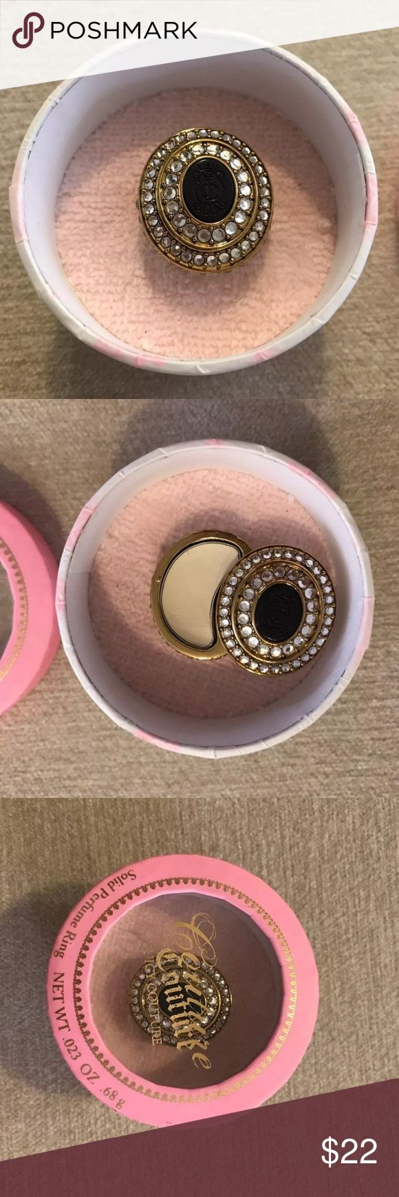 Juicy Couture Perfume Ring ✨Excellent condition!✨   ✨Limited Edition✨  All gold ring with faux diamonds and black logo in the middle. Slide open the ring and the smell/swatch the perfume cream. (Swatched once) all diamonds are still intact. Has adjustable ring band. Squeeze together to tighten. Comes with original box.   R E T A I L : $42 Juicy Couture Jewelry Rings