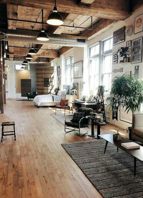 loft living space / wood / high ceilings / large windows