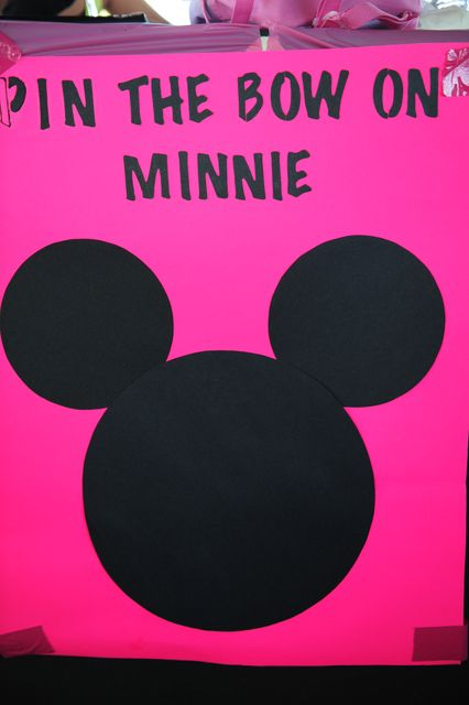 We made the Mickey/Minnie heads out of black poster board.  I printed minnie bows and Mickey hats on clear 2x4 shipping labels.