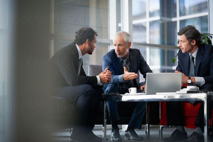 Mature business people discussing business strategy