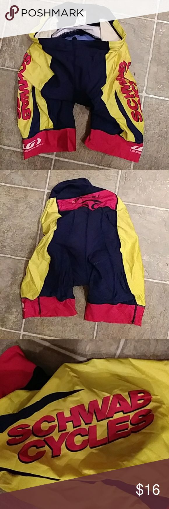 Mens LOUIS GARNEAU Padded Cycling Shorts LARGE Mens large. Yellow, black, red. Padded chamois is blue. 74% nylon 26% polyester. Pre owned. Excellent condition. louis garneau Shorts