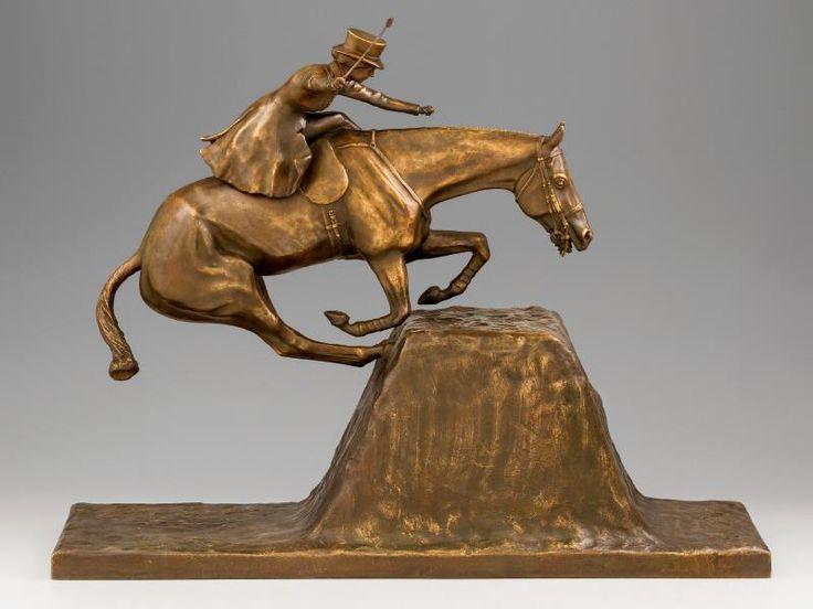 Lois Aguiar jelzéssel - Akadályugrás Öntött, patinázott bronz. Női lovas akadályugrás közben. Lovaglópálca restaurált. Talapzatán jelzett: L. Aguiar 1910. M.: 43 cm Kikiáltási ár: 240 000 Ft Katalógus szám: 617
