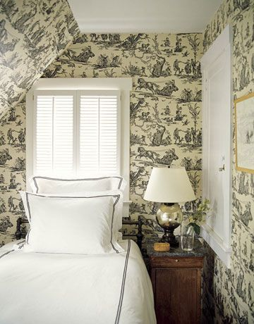 small room enveloped in black and white toile