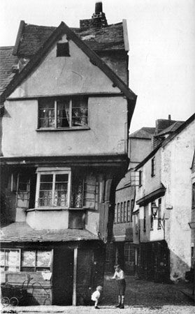 """The Tudor """"Merchant's House"""" in Exeter, Devon, England, UK was built circa 1500. This photo was taken in 1922. The house was saved & moved in 1961 to make way for a new road and can still be seen today, restored to its full glory."""
