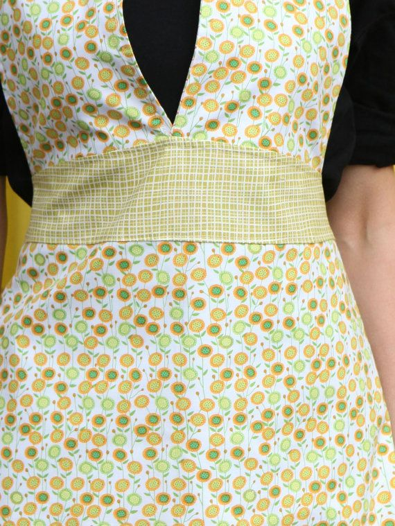 So cute. . .one of a kind!  Friday Night Apron  Sunflowers by QuiltsbyNona on Etsy, $27.00