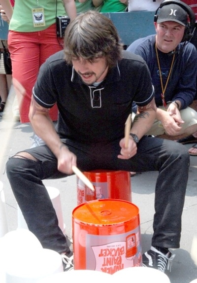 just the greatest drummer in the world playing drums on some buckets on the street in nyc