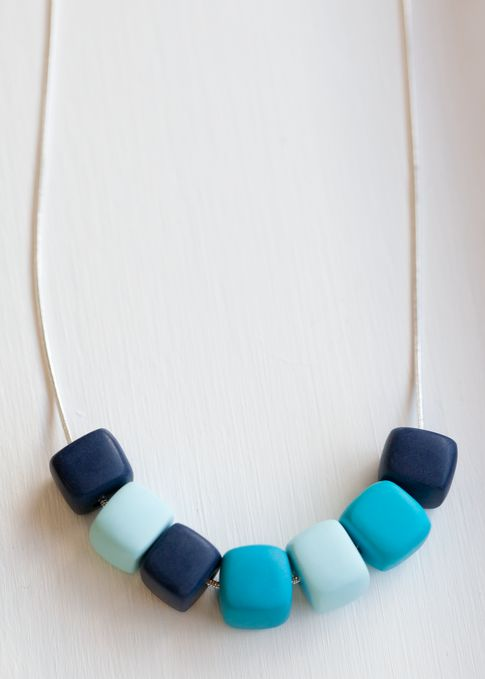 Blue Lagoon Cube Necklace $26.00 Each necklace is made using clay beads, hanging on a sterling silver chain. Each bead is individually handmade, they each have their own unique character and no two necklaces will ever be the same.All pieces are individually made to order in my Adelaide studio. www.marliandmo.com.au