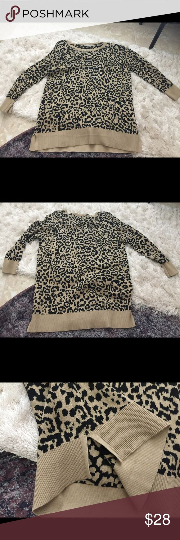 Banana Republic leopard sweater NWOT. Lovely leopard sweater. Size large but could fit a medium (wear it as an oversized sweater). Cute mini slits on the bottom sides. From a smoke free home. Reasonable offers welcomed. Banana Republic Sweaters