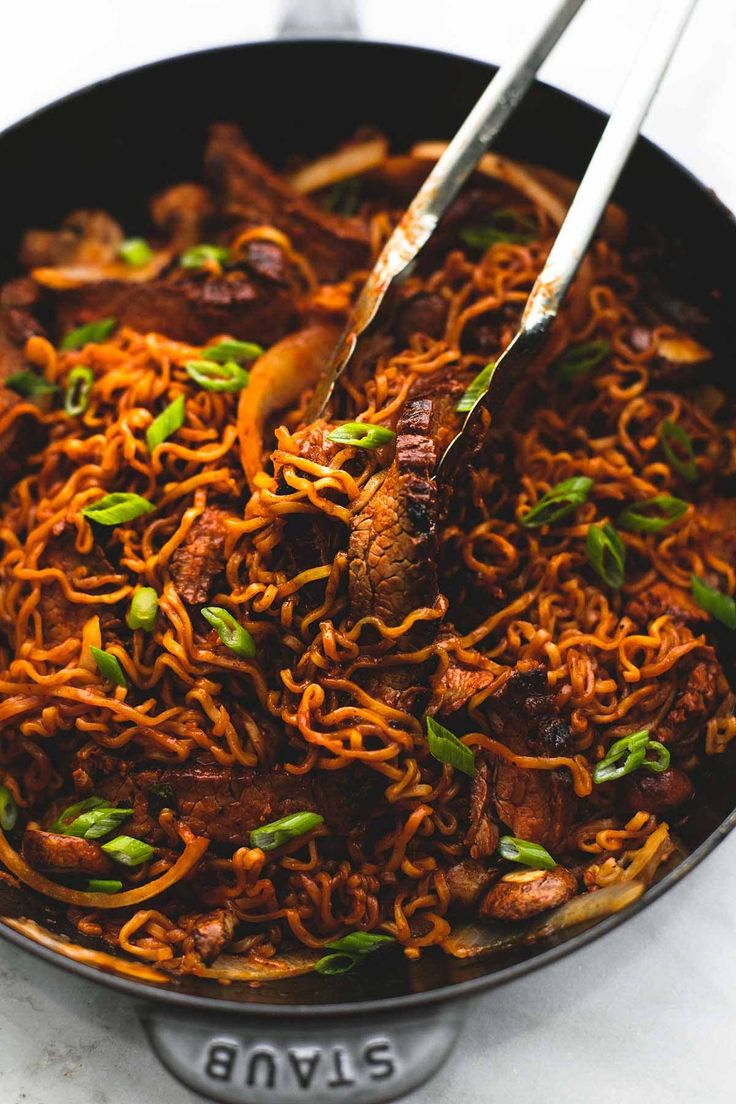 One pan spicy Korean beef noodles recipe made with a simple Korean marinade and ramen noodles with onions and mushrooms, ready in 30 minutes!