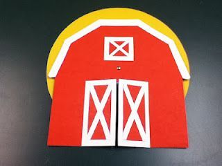 """Whose in the Big Red Barn? Find out when you sing """"Old McDonald Had a Farm"""" with this creative """"spinning wheel"""" song prop."""