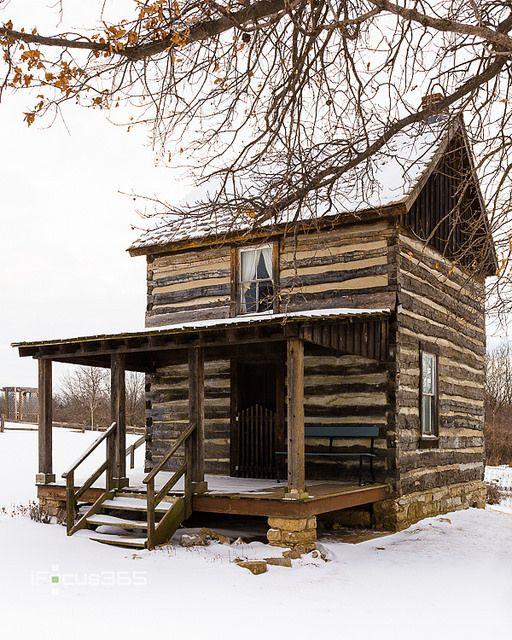 historic log cabin in snow