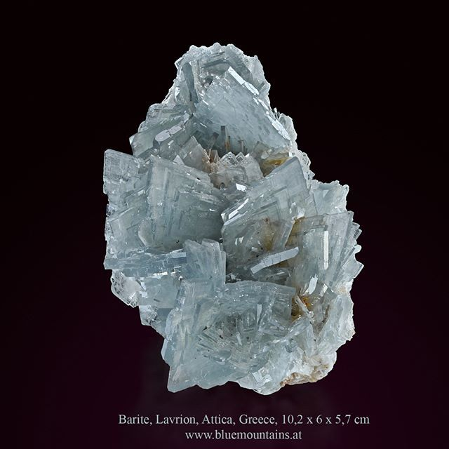 Barite Location: No145, Plaka mines area, Lavrion, Attica, Greece size: 10,2 x 6 x 5,7 cm available at  www.bluemountains.at  This specimen has beautiful, sharp, highly lustrous and translucent crystal groups of light blue-gray barite. Individual barite crystals are up to 25 mm long. This is a very aesthetic specimen with no visible damage, except for where the specimen was extracted from the rock.