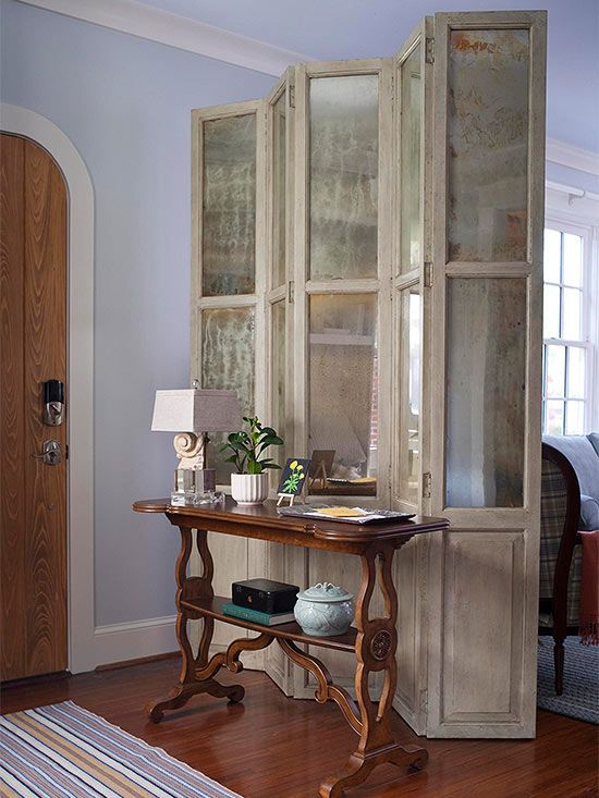 Fake an Entryway with a Partition. In this home, the front door opens immediately to the living room, but a freestanding folding screen offers slight separation between the areas. In addition to saving money on a costly renovation, the partition defines space while still allowing light to pass freely throughout the faux entry and living room.