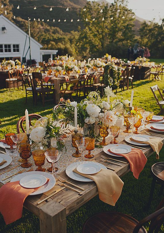 Love this fall wedding tablescape - the amber goblets with the farm tables, and gold utensils is downright gorgeous