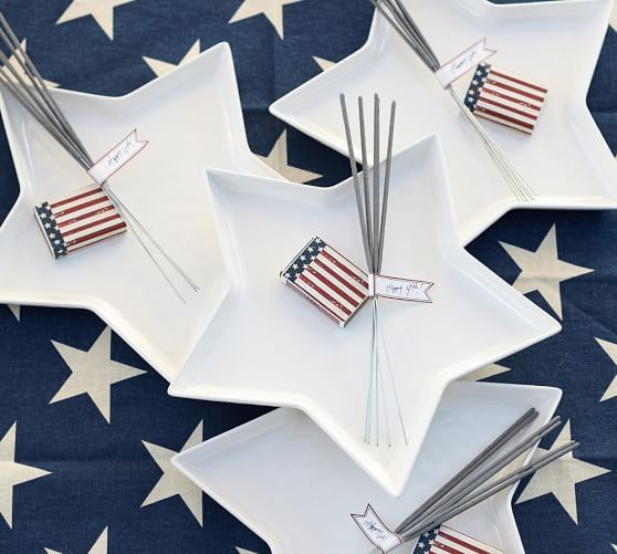 I love how #PotteryBarn accented these plates with sparklers & matches - I may have to do the same