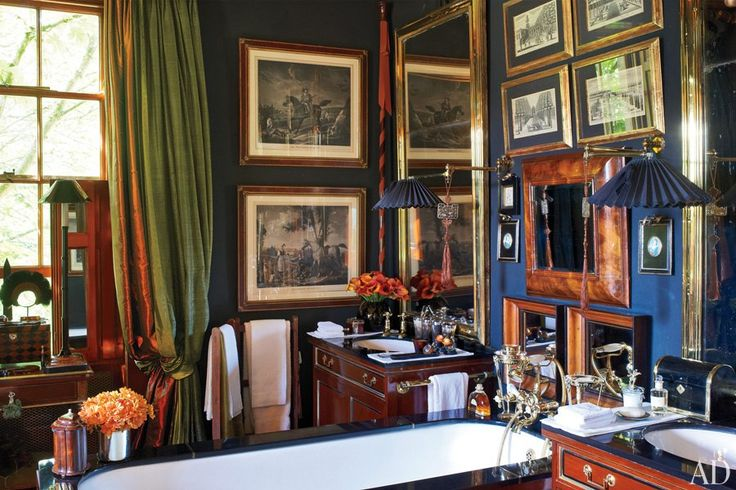 An array of 18th- and 19th-century prints line the master bath, alongside French brass café mirrors and antique sconces.