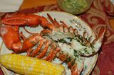 Picture of Grilled Lobster with Corn on the Cob and Basil Butter Sauce - Guide to Grilling Lobsters