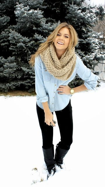 Pair a light blue denim shirt with black leggings for a trendy and easy going look. Black leather knee high boots will bring a classic aesthetic to the ensemble.  Shop this look for $101:  http://lookastic.com/women/looks/scarf-denim-shirt-watch-leggings-knee-high-boots/7050  — Tan Knit Scarf  — Light Blue Denim Shirt  — Gold Watch  — Black Leggings  — Black Leather Knee High Boots