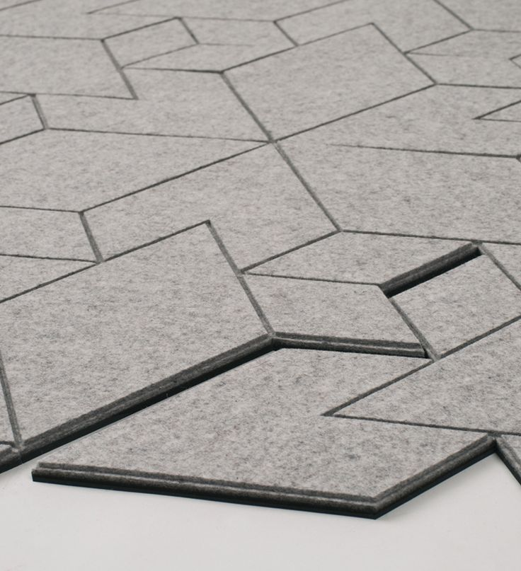 Rug tiles reflect the sophistication of pavement patterns and city grids. Rug tiles use hexagonal grid. Felt used is 100% wool and though it simulates concrete pavement, it is warm to touch.  We're on the lookout for a manufacturer to collaborate with on this design! Do contact us, there is quite a lot of potential clients unhappy about not being able to buy it.