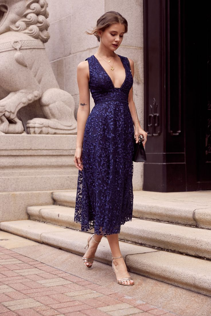 navy blue winter wedding guest dess with plunging neckline