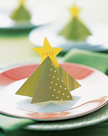 Tree Place Card Martha Stewart...Download and print tree and star designs onto card stock; cut out. An adult should cut a slit in tree's center with a utility knife where indicated. At each set of opposite arrows, fold paper in half, crease, and unfold: For green arrows, fold so design is on inside; for red, fold so it's outside. Form into tree shape. Write name on star; insert into slit.