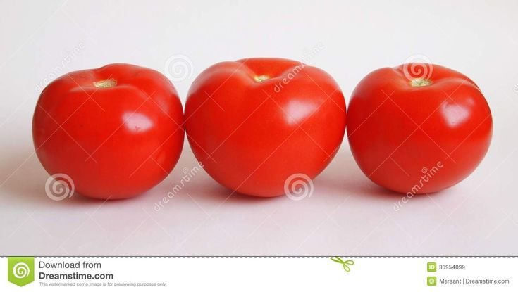 Three tomatoes with white background
